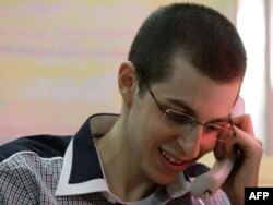 Israeli soldier Gilad Shalit speaks with his family on the telephone.