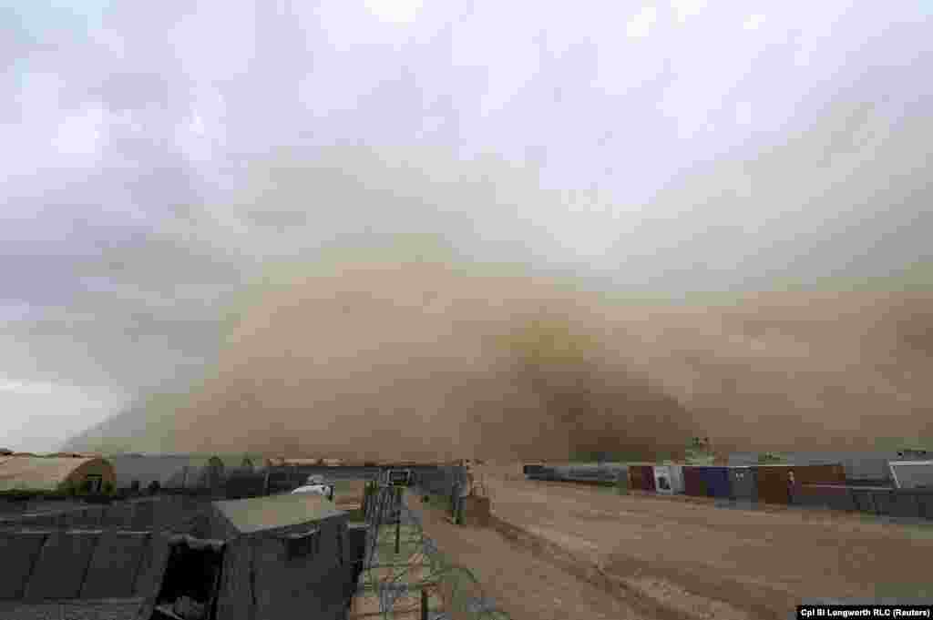 A sandstorm approaches the camp of British forces in Helmand Province, Afghanistan, on June 3.