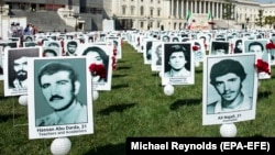 A file photo of a protest in Washington, D.C. showing images of the alleged victims of state-sponsored executions of Iranian political prisoners.