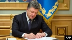 Ukrainian President Petro Poroshenko signed the new legislation into law on September 25. (illustrative photo)