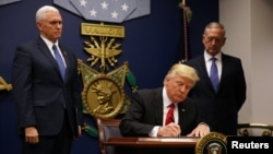 U.S. President Donald Trump signs his executive order on travel on January 27.