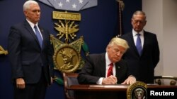 U.S. President Donald Trump signs the initial executive order on immigration on January 27.