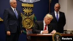 U.S. President Donald Trump signing the first executive order on travel on January 27.