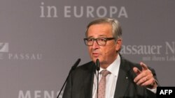 European Commission chief Jean-Claude Juncker speaks during a press conference on October 8, 2015 at the border town of Passau, Germany.