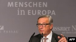 European Commission chief Jean-Claude Juncker speaks during a press conference on October 8 at the border town of Passau, Germany.