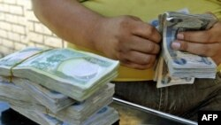 A stack of currency at a stall in central Baghdad's Fardus Square (file photo)