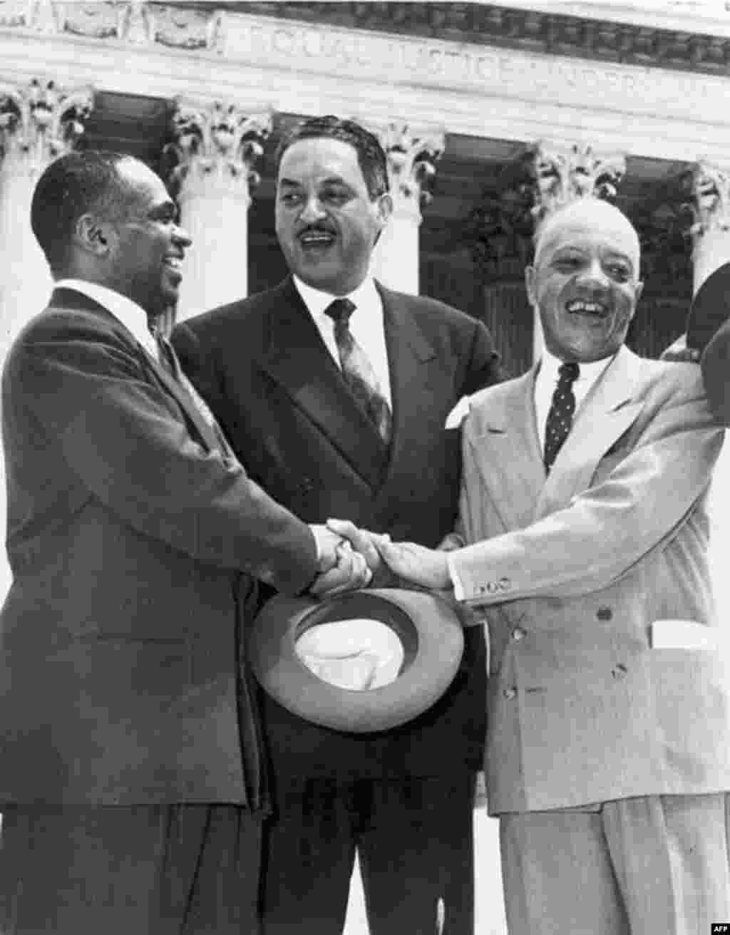 Lawyers Thurgood Marshall (center), George E.C. Hayes (left), and James Nabrit celebrate the Supreme Court's decision in Brown v. Board of Education on May 17, 1954. The ruling declared racial segregation in schools to be unconstitutional. In 1967, Thurgood Marshall became the first African-American to be appointed to the Supreme Court.