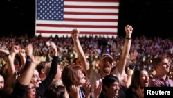 Supporters of President Barack Obama cheer during his election night rally in Chicago on November 6.