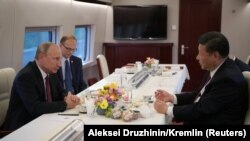 Китайн куьйгалхочуьнца Си Цзиньпинца цхьаьна Путин Владимир хахкавелира лаккхара сихаллин цIерпоштана тIехь.