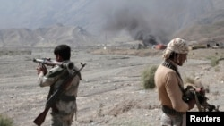 Afghan border police keep watch after a Taliban attack at Torkham district in Jalalabad Province on September 2.