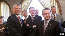 Kosovar President Hashim Thaci (left) and Serbian Foreign Minister Ivica Dacic (right) have both suggested they are open to the idea of redrawing their countries' border. (file photo)