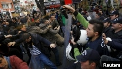Turkish police use a tear-inducing agent against demonstrators during a protest over the arrest of two reporters in Ankara late last year. Turkish President Recep Tayyip Erdogan was singled out in the Freedom House report for his crackdown on journalists.