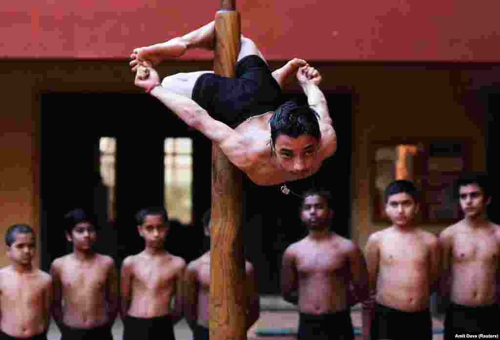 A participant practices Mallakhamb, traditional Indian gymnastics, during a practice session ahead of an upcoming competition to promote the sport, in Ahmedabad on January 28. (Reuters/Amit Dave)