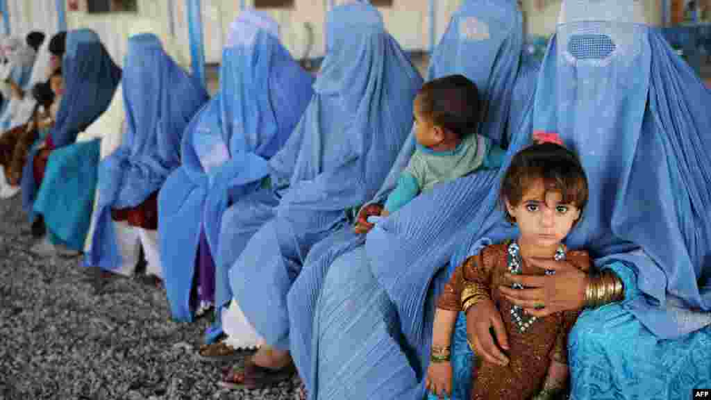 Afghan women and children at a UNHCR registration center in Pakistan. Nearly 26 million displaced people were receiving protection or assistance from the UN's refugee agency by the end of 2011.