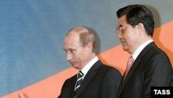 Rusiä prezident Vladimir Putin (s) häm Qıtay prezidentı Hu Jintao Rusiädä Qıtay yılın aça, Mäskäw, 26Mar2007
