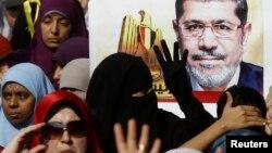 Сторонники Мухаммеда Мурси, свергнутого президента Египта, протестуют на улицах.