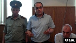 "Azerbaijani journalist Eynulla Fatullayev stands trial for possession of drugs in 2010. He was found guilty of the charges, which Amnesty International described as ""fabricated,"" and sentenced to 2 1/2 years imprisonment."