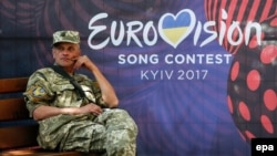 A Ukrainian serviceman rests near the Eurovision Song Contest fan zone on Khreshchatyk Street in downtown Kyiv.
