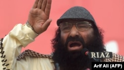 PAKISTAN -- Hizb ul-Mujahideen chief Syed Salahuddin addresses a protest rally against the killings in Indian-administered Kashmir, in Lahore last month.