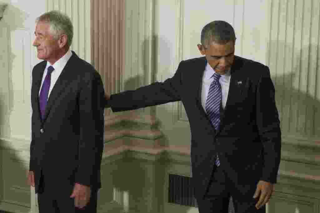 U.S. President Barack Obama walks away from the podium with Secretary of Defense Chuck Hagel (left) following the announcement that Hagel will step down from his post after less than two years in office. (epa/Michael Reynolds)
