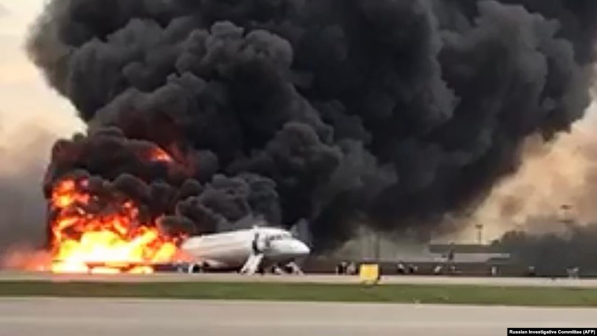 Burning jet makes emergency landing at moscow airport killing at least 13