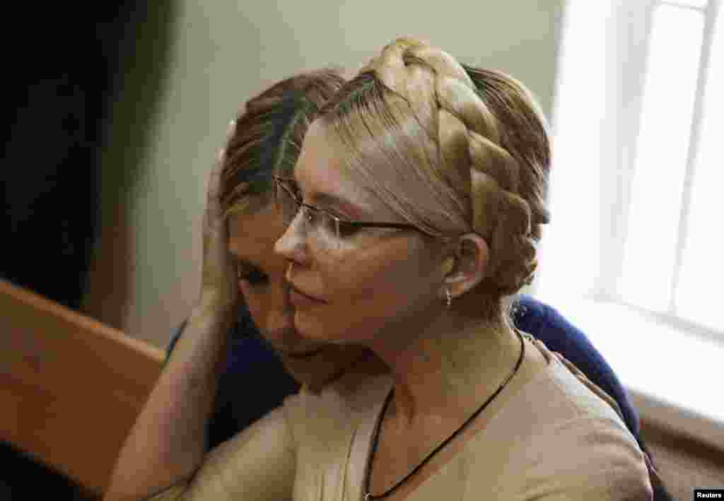 Yulia Tymoshenko is comforted by her daughter Yevhenia in after the verdict is read. Yevhenia has been advocating for her mother's release from prison.