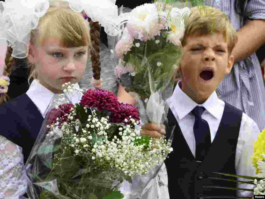 A child yawns during a ceremony to mark the start of another school year in Russia's Far Eastern city of Vladivostok. (Photo by Yuri Maltsev for Reuters)