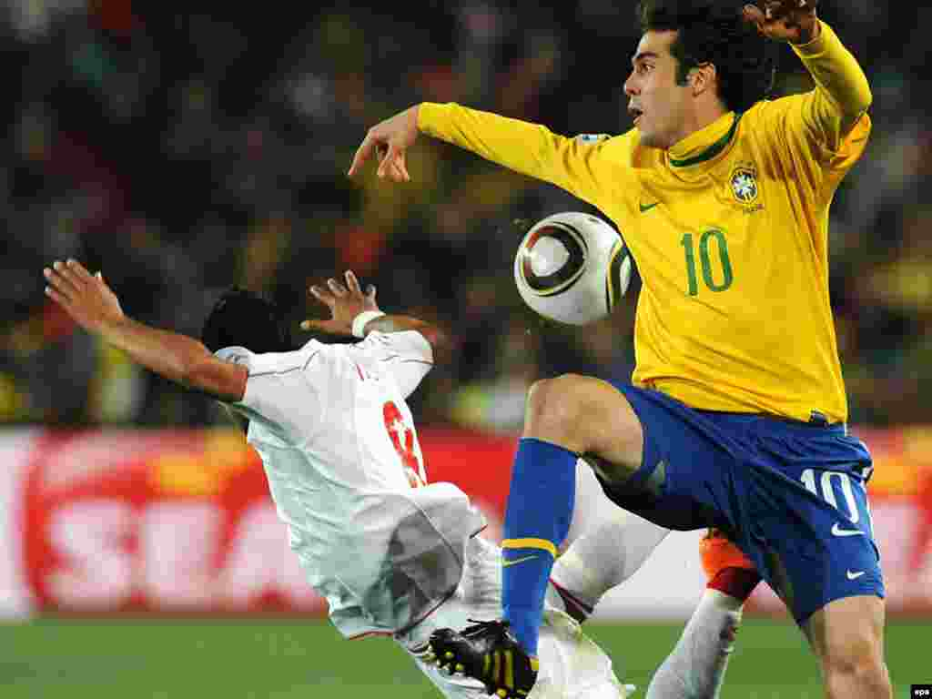 Arturo Vidal of Chile (left) and Kaka of Brazil battle for the ball during the Round of 16 at the football World Cup in South Africa. Brazil won 3-0, moving on to the quarterfinal. Photo by epa