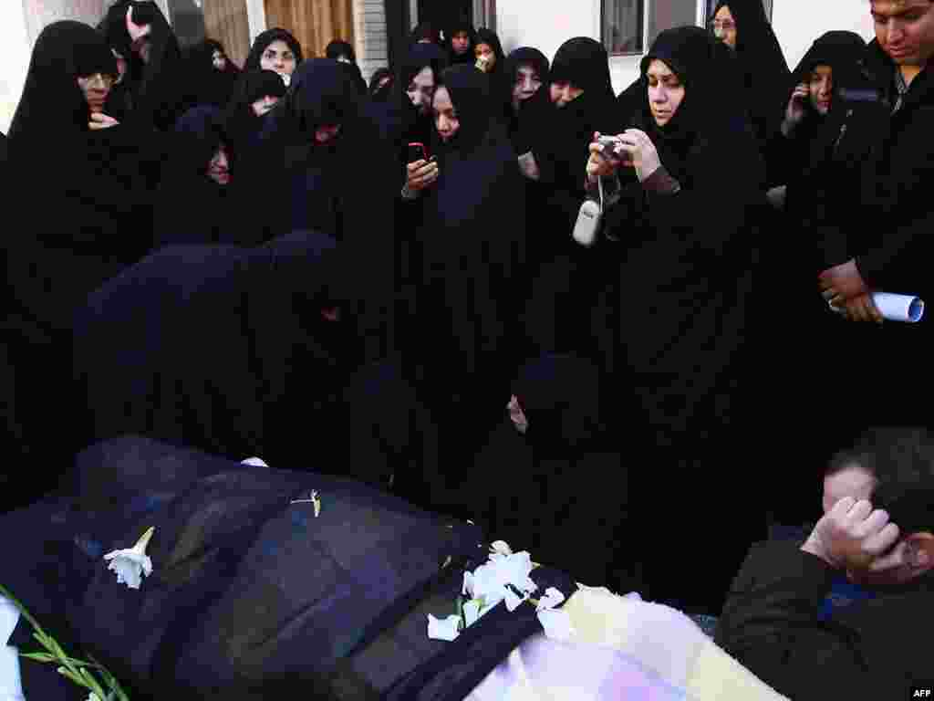 Many of the mourners began arriving in Qom on December 20, a day before his funeral.