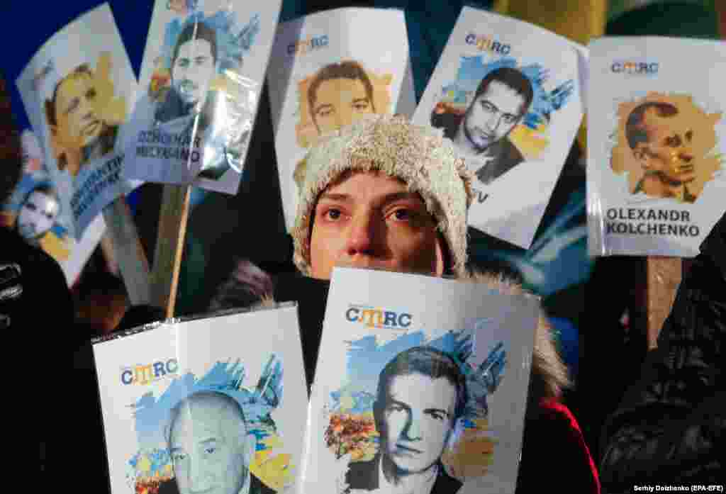 Ukrainian and Crimean Tatar activists hold placards with the names of people who support Ukraine and who disappeared or were arrested by Russian authorities in Crimea, during a rally on Independence Square in Kyiv on February 26. Activists were marking the Day of Crimean Resistance to the Russian Occupation. (epa-EFE/Sergei Dolzhenko)