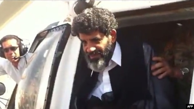 Abdullah Senussi, a former spy of late Libyan leader Muammar Qaddafi, arriving at the high-security prison facility in Tripoli in September 2012.