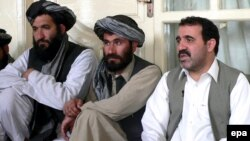 Ahmed Wali Karzai (right), the president's brother, sits in early April with other members of Kandahar's provincial council.