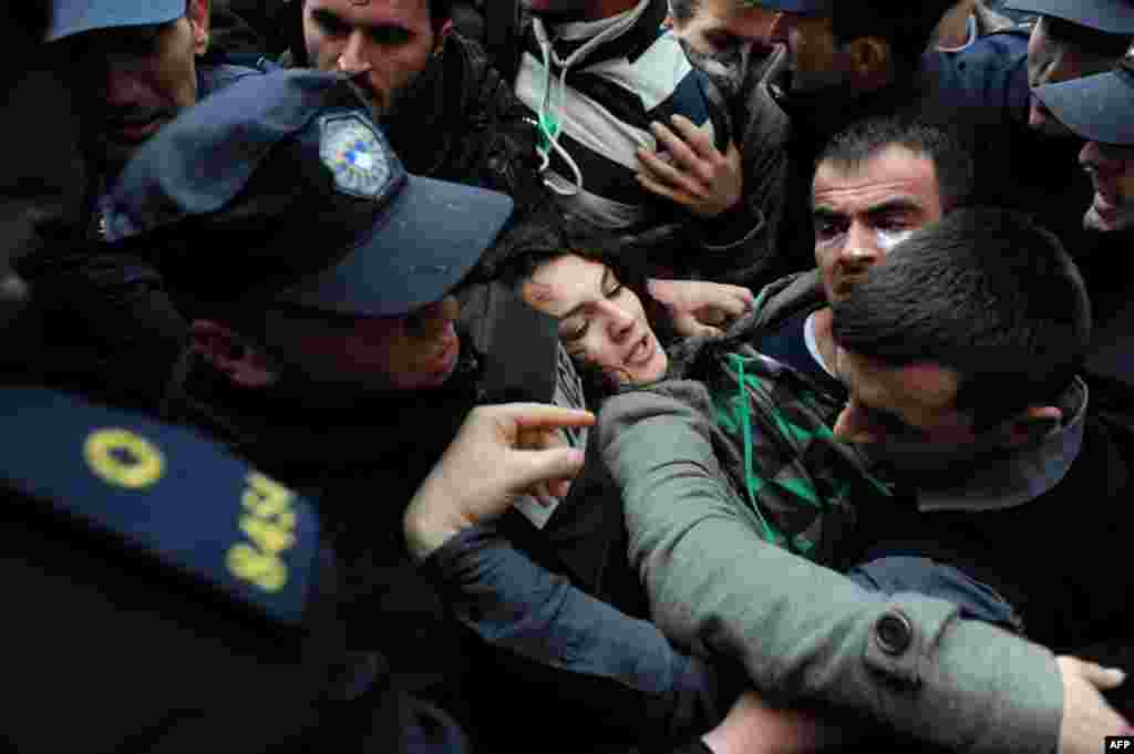 Student protesters clash with policemen during a demonstration in front of the local education authority in Pristina, Kosovo, over the questionable validity of some university professors' qualifications. (AFP/Armend Nimani)