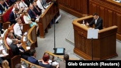 Ukrainian President Volodymyr Zelenskiy addresses lawmakers during the first session of parliament in Kyiv last week.