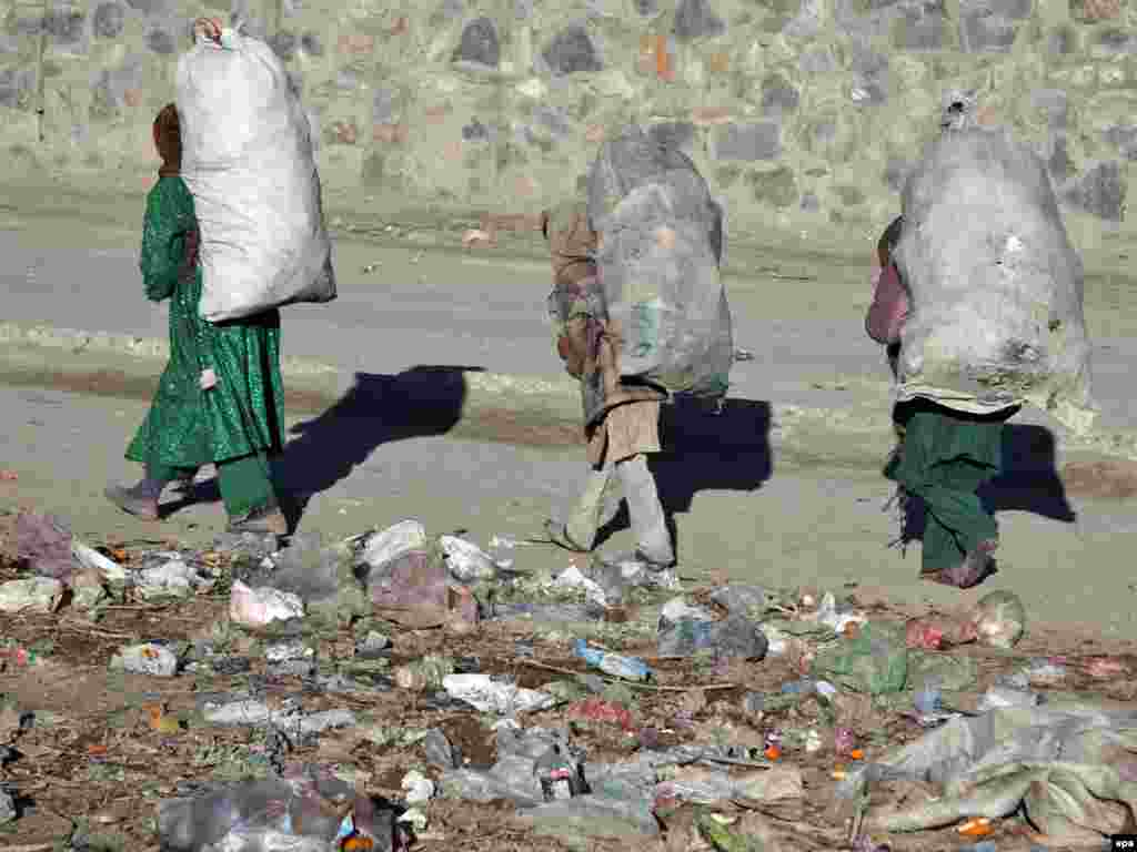 Afghanistan -- Girls collect garbage from the street in Kabul, 28Feb2011