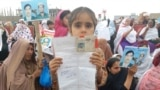 Thousands of women, children, and men held up photos, placards, or the natoinal ID cards of their missing family members.