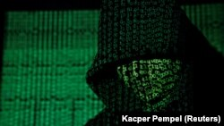 A projection of cyber code on a hooded man - generic
