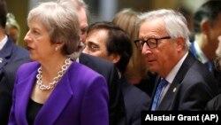 Премьер-министр Тереза Мэй и глава Еврокомиссии Жан-Клод Юнкер