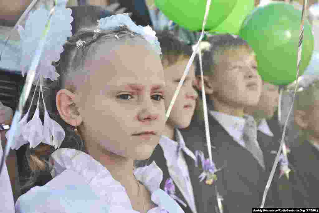 Six-year-old Alina Kalunuchenko on her first day at School No. 42 in Lugansk, Ukraine.