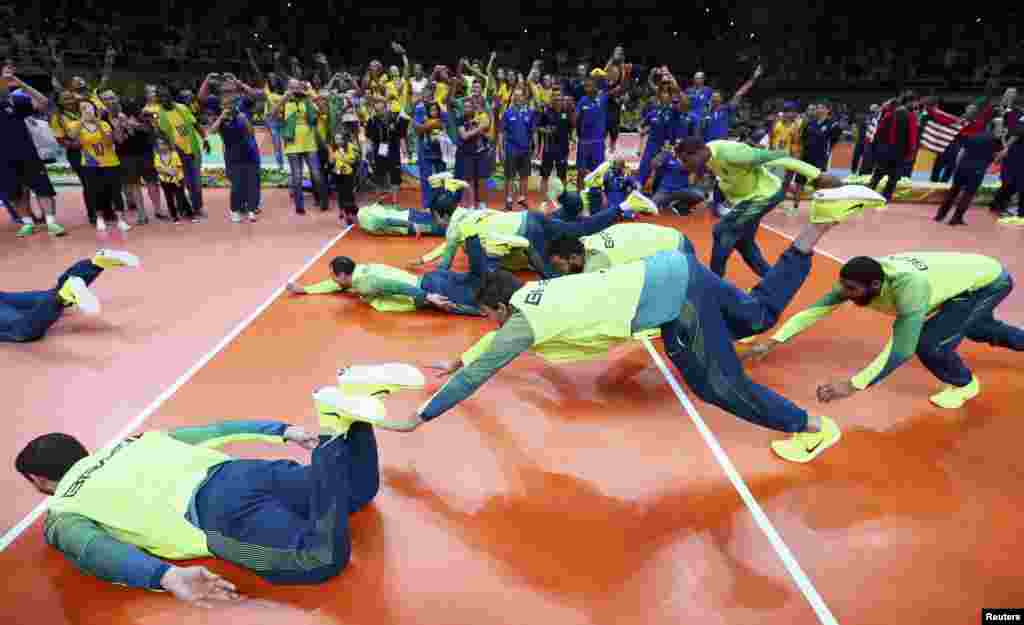 The Brazilian men's volleyball team celebrates their victory after they beat Italy for the gold medal.