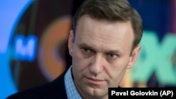 Aleksei Navalny is calling on Russians to boycott next month's presidential vote.