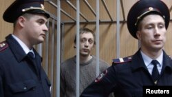 Bolshoi ballet dancer Pavel Dmitrichenko (center) pleaded not guilty to ordering an acid attack on the troupe's artistic director.