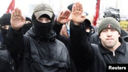 Ultranationalists march during a demonstration on the outskirts of Moscow.