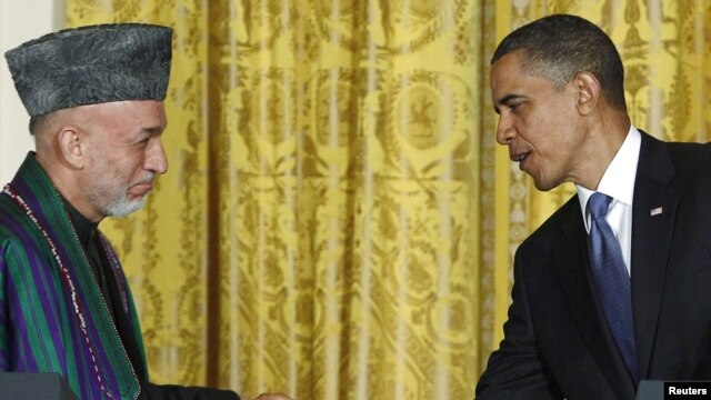 Afghan President Hamid Karzai (left) has questioned U.S. President Barack Obama's (right) announced deadline to start withdrawing U.S. troops.