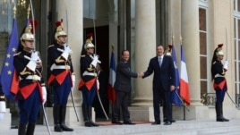 France - President Francois Hollande (L) greets his Azerbaijani counterpart Ilham Aliyev outside the Elysee Palace in Paris, 18Sep2012.