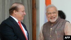 Indian Prime Minister Narendra Modi (R) met with Pakistani Prime Minister Nawaz Sharif in New Delhi on May 27, 2014.