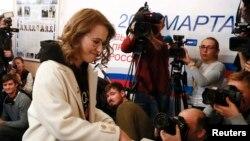 Ксения Собчак, кандидат в президенты России, на избирательном участке в Москве. 18 марта 2018 года.