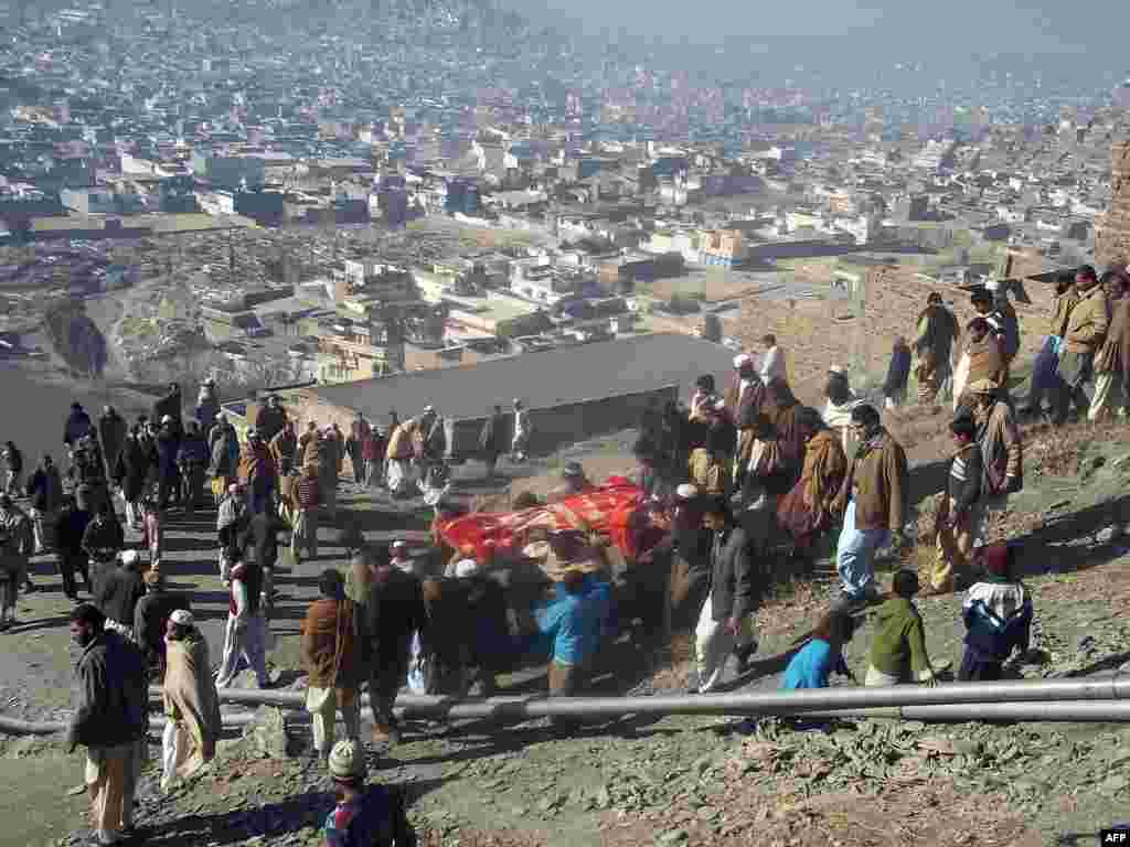 People carry the coffin of a bombing victim in Mingora.