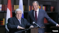 Syrian Foreign Minister Walid Muallem (left) and his Russian counterpart, Sergei Lavrov, give a joint press conference following their talks in Sochi on November 26.