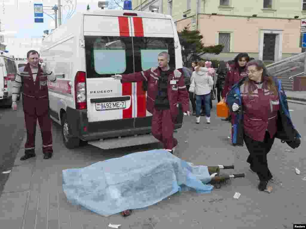 Medics surround the body of a victim.